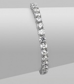 EXCLUSIVELY AT SAKS. Clear cubic zirconia stones in a classic tennis bracelet design.Cubic zirconia Rhodium plated sterling silver Length, about 7 Push lock closure Imported