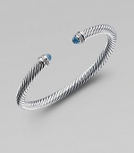 From the Color Classic Collection. A signature Yurman cable of sterling silver, richly enhanced by bands of pavé diamonds encircling blue topaz end caps. Diamonds, .09 tcw Blue topaz Sterling silver Width, 5mm Diameter, about 2½ Made in USA