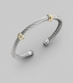 From the Thoroughbred Collection. A signature Yurman sterling silver cable, richly adorned with two textured bands of 14k gold. Sterling silver & 14k yellow gold Cable, 5mm Diameter, about 2¼ Made in USA
