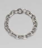 Alternating smooth and cable links create a bracelet that's both classic and of-the-moment with true Yurman style. Sterling silver Length, about 7¼ Spring ring clasp Imported