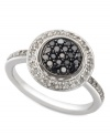Circular chic. Black (1/4 ct. t.w.) and white (1/4 ct. t.w.) diamonds make a stunning statement in this sterling silver ring. Size 7.