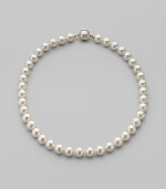 A classic strand of white organic man-made pearls is essential elegance. 10mm white round pearls Length, about 18 18k gold vermeil and mabé pearl push-lock clasp Made in Spain
