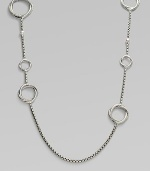 From the Infinity Collection. A signature Yurman box chain of sterling silver is gracefully stationed with cable-and-smooth interlocking rings and sprinkled with tiny white pearls. 5.5mm white cultured freshwater pearls Sterling silver Length, about 44 Toggle closure Imported
