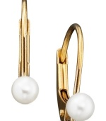 These dainty 14k gold leverback earrings are adorned with a single luminous cultured pearl.