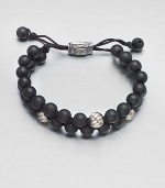 Smooth and polished beaded bracelet of black onyx and sterling silver with logo-engraved clasp.Black onyxSterling silverAdjustable claspAbout 2½ diam.Imported