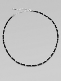 A single strand of black onyx beads and sterling silver stations makes a modern statement.Sterling silverOnyxAbout 19½ long with 4½ extenderLobster claspImported