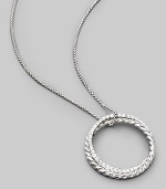 From the Silver Ice Crossover Collection. Two intertwining rings, one of sterling silver cable, the other of white gold set with pavé diamonds, hanging elegantly from a sterling silver box chain. Diamonds, 0.39 tcw Chain length, about 16 Pendant diameter, about 1 Lobster clasp Made in USA