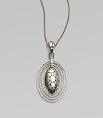 From the Kali Zen Collection. A graceful yet striking oval - with the Kali stepping-stone texture on the front, an open filigree back and rope chain edging - hangs from a sterling silver woven chain. Sterling silver Chain length, about 36 Pendant length, about 2½ Pendant width, about 1¼ Lobster clasp Made in Bali