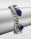 From the Black Tie Optional Collection. A chunky curb chain is joined by a row of sapphire blue and clear faceted stones in this fun design, the two strands creating a quirky complement to one another.Glass and plasticSilvertoneLength, about 8Ring claspImported