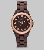 A ultra-lightweight design with a playful logo accented dial. Quartz movementWater resistant to 5 ATMRound brown aluminum case, 36mm (1.4)Smooth rose goldtone ion-plated bezelBrown dialLogo hour markersSecond hand Brown aluminum bracelet, 18mm wide (0.7)Imported