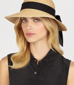 Fine braided raffia accented with polka dot ribbon trim can be worn with brim turned up or rolled down. Bow at back Adjustable sizing cord Brim, about 3½ Imported