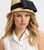 This sweet design showcases a large, whimsical bow. StrawBrim, about 2Cotton linedClean with damp clothMade in Italy