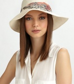 Soft linen, in a floppy style accented with a printed, ruched band of chiffon.Ruched chiffon bandBrim, about 3LinenHand washMade in USA of imported fabric