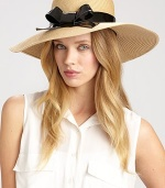 A charming design with a glossy bow accent to keep the sun out of your eyes. PolyesterBrim, about 4Imported