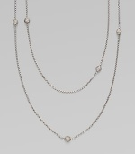 From the Petite Pavé Bead Collection. A long and graceful box-link chain of shining sterling silver, sprinkled with shimmering pavé diamond beads. Diamonds, 0.59 tcw Sterling silver Length, about 36 Lobster clasp Imported