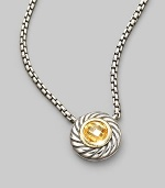 From the Color Classic Collection. A swirled sterling silver cookie pendant, with a faceted center of glowing citrine, on a bold box chain. Citrine Sterling silver Chain length, about 16 Pendant diameter, about ½ Lobster clasp Imported