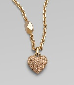 Be brilliant in this dazzling crystal encrusted heart pendant on a logo accented link chain. Palladium plated or goldtoneCrystalsLength, about 14Pendant size, about ½Spring ring closureImported
