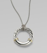 From the Metro Collection. A sleek, sophisticated circle, combining smooth and cabled sterling silver with accents of 18k gold, hangs from a richly textured silver chain and bale. Sterling silver and 18k yellow gold Chain length, about 18 Pendant diameter, about 1¼ Spring ring clasp Imported