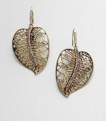 Nature beckons with this dazzling stone accented leaf design. Glass stonesAntique-finished goltoneLength, about 2.25Hook backImported
