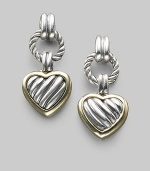 From the Heart Collection. A cabled sterling silver heart drop, edged in 18k gold, boldly hangs from a cabled silver ring. Sterling silver and 18k yellow gold Drop, about 1 Post back Made in USA