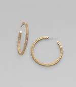 EXCLUSIVELY AT SAKS. Feminine filigree hoops, with dazzling pavé-set crystals. Crystal 18k goldplated Diameter, about 1½ Post back Imported