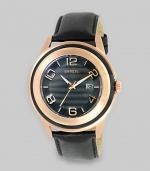 Perfect for the sophisticated man, a black-and-gold beauty with modern numeric markers and a sleek leather strap.Quartz movementWater resistant to 10 ATMRound rose gold IP and glass case, 45mm (1.8)Smooth rose gold IP bezelBlack dialNumeric markersDate display at 3 o'clockSecond handBlack leather strapImported