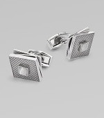 High-polish rhodium-plated metal with a fixed square back, hatched texture and rotating tiers. T backingAbout ½ diam.Plated metalMade in the United Kingdom