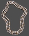 Soft pink and peach tones add subtle accent to this beautiful cultured freshwater pearl (7-8 mm) necklace. Approximate length: 64 inches.