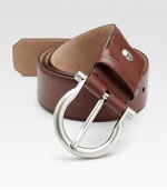 This distinguished style is rendered in luxe saddle leather with an adjustable design and shiny palladio gancini buckle.CalfskinPalladio buckleAbout 1½ wideMade in Italy