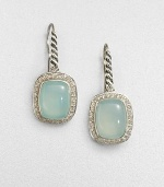 From the Noblesse Collection. A pretty aqua chalcedony cabochon center surrounded by a diamond accented border set in sleek sterling silver. Aqua chalcedonyDiamonds, .42 tcwSterling silverLength, about .39Hook backImported
