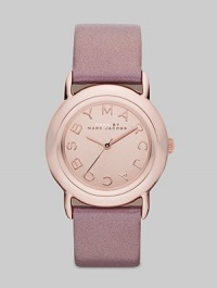 Smart and chic style with leather strap. Quartz movement Water resistant to 5 ATM Round ion-plated rose gold stainless steel case, 33mm (1.3) Rose gold mirror logo dial Second hand Metallic blush leather strap, 18mm wide (0.7) Imported
