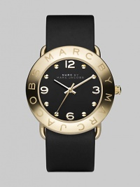 Streamlined timekeeping with a polished goldplated finish and fine leather strap.Quartz movement Water resistant to 3 ATM IP (ionic plated) gold bezel with engraved logo Stainless steel round case, 36mm, (1.42) Black dial IP gold numeral and hour markers Leather strap, 20mm, (.79) Imported