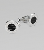 Polished sterling silver cuff links with round carbon center and logo detail.BrassAbout ½ diam.Imported